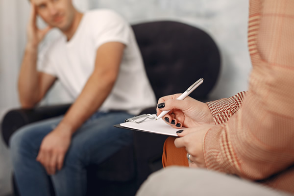 Adult in counseling with therapist