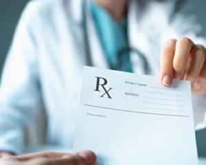 Doctor holding prescription